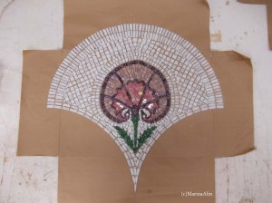 Mosaic pieces glued to craft paper face down