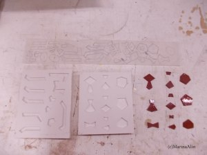 Tracing paper with tile shapes traced, rubber tile shapes, plaster moulds